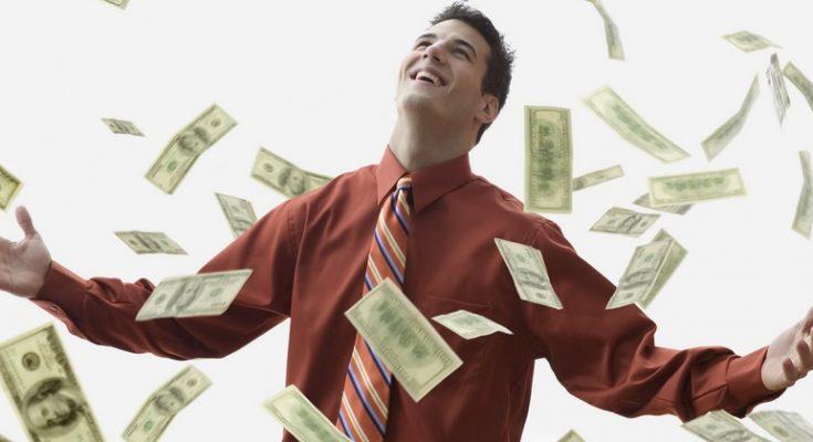 corbis - soldi - Money Falling on Happy Businessman --- Image by © JLP/Jose L. Pelaez/Corbis